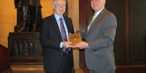 Tom Stenzel accepts Society history from David Webster